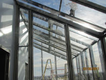 Installing the glazing for the PC3 Glasshouse